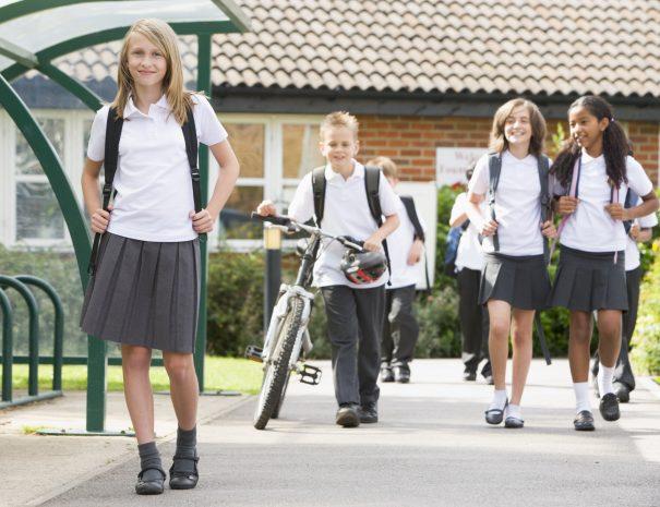 shutterstock_77073577Older kids in uniform walking at school